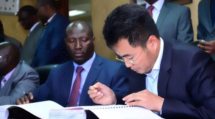 CSCEC general manager Zhang Ruiping and KeNHA director general Peter Mundinia